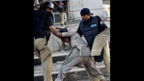 """Pakistani police detain a demonstrator in Lahore on Friday during a protest against the film """"Innocence of Muslims."""""""