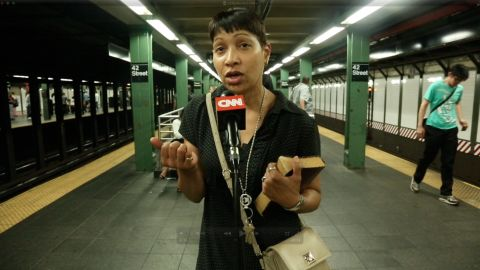 People on the subway step up to CNN's Open Mic to talk about how they use their cell phones.