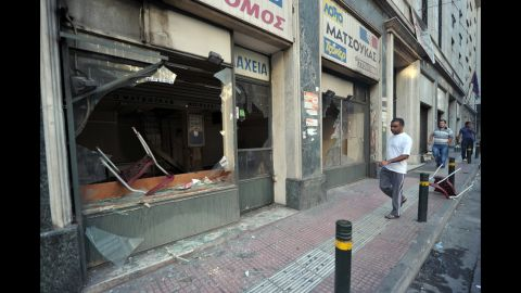 Protesters smashed the windows of a store during a demonstration in central Athens.