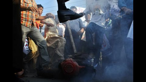 """Pakistani demonstrators beat an effigy of Florida pastor Terry Jones during a protest against an anti-Islam film in Lahore on Monday, September 24. More than 50 people have died around the world in violence linked to protests against the low-budget movie, which mocks Islam and the Prophet Mohammed, since the first demonstrations erupted on September 11. <a href=""""http://www.cnn.com/SPECIALS/world/photography/index.html"""">See more of CNN's best photography</a>."""