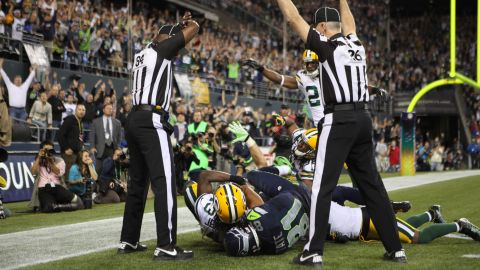 The Seattle Seahawks defeated the Green Bay Packers 14-12 on Monday, September 24, after replacement officials, standing in for locked-out NFL regulars, gave possession of a disputed ball to Seattle receiver Golden Tate. Officials in the end zone gave competing signals: one indicating a touchdown, the other an interception.