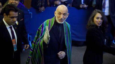 Afghan President Hamid Karzai, center, arrives on Tuesday.
