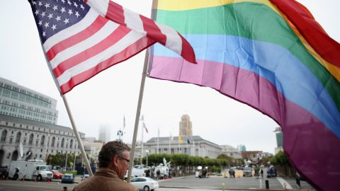 A demonstrator waves American and gay pride flags in San Francisco in 2010. California voters approved a ban on same-sex marriage.