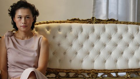 LIMITED USE: Image #: 19539699    Gigi Chao, the daughter of Hong Kong property tycoon Cecil Chao Sze-tsung, poses at the conference room of her office in Hong Kong September 27, 2012. A flood of men offered dates and marriage proposals to the lesbian daughter of Cecil Chao who was willing to pay $500 million HKD ($64 million) to a successful son-in-law. Gigi, who works with her father as the executive director of the family-owned Cheuk Nang Holdings Ltd, told Reuters in an exclusive interview that she saw her father's announcement as an act of love.  REUTERS/Bobby Yip (CHINA - Tags: SOCIETY BUSINESS)       REUTERS /BOBBY YIP /LANDOV