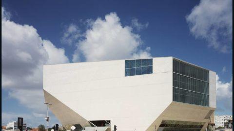 "The <a href=""http://www.casadamusica.com/Default.aspx?langSite=eng"" target=""_blank"" target=""_blank"">Casa da Musica</a> in Porto, Portugal, won Koolhaas the <a href=""http://www.pritzkerprize.com/"" target=""_blank"" target=""_blank"">Pritzker Prize</a> in 2000."