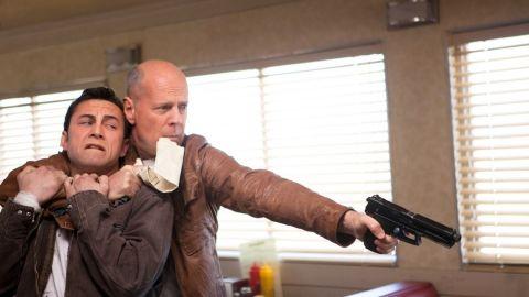 """Joseph Gordon-Levitt and Bruce Willis star as Joe in """"Looper,"""" a time travel thriller."""