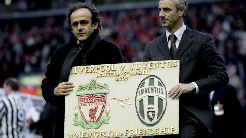"""Striker Ian Rush, right, spent one season at Juve in 1987-88 between two spells at Liverpool. Before the first leg of the 2005 quarterfinal at Anfield, Liverpool supporters held up a mosaic to form the word """"Amicizia"""" (friendship). Some of the visiting Juve fans applauded, but many turned their backs in disgust. There is also a Heysel memorial plaque at Liverpool's Anfield Stadium."""