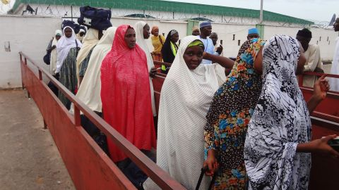 Nigerian Hajj pilgrims leave the airport after being denied entry by Saudi Arabian officials.