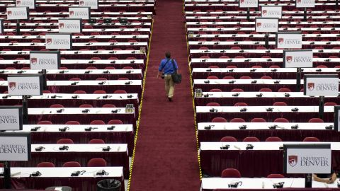 A man walks through the media center as preparations continue on Monday.