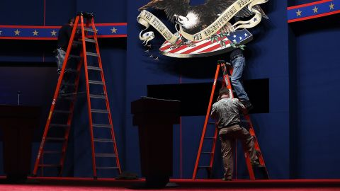 Workers make adjustments to the stage on Tuesday.