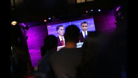 People watch at Galapagos Art Space in Brooklyn as U.S. President Barack Obama and Republican presidential candidate, former Massachusetts Gov. Mitt Romney participate in their highly anticipated first debate Wednesday night at the University of Denver on October 3, 2012 in New York City. The debate is broken into three segments: the economy,health care and the role of government. Romney, who is trailing in most major polls, is looking to deliver a strong performance in order to gain leverage over the president going into the final weeks of the campaign.