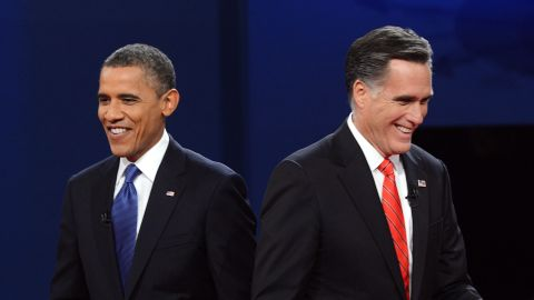 US President Barack Obama (L) and Republican presidential candidate Mitt Romney finish their debate at the University of Denver in Denver, Colorado, October 3, 2012. After hundreds of campaign stops, $500 million in mostly negative ads and countless tit-for-tat attacks, Obama and Romney go head-to-head in their debut debate. AFP PHOTO / Saul LOEB (Photo credit should read
