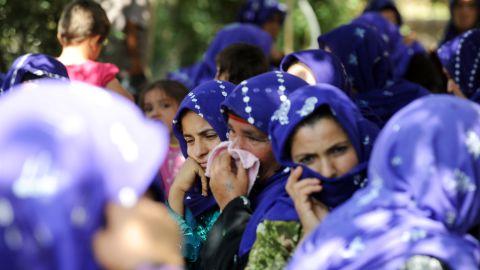 Local women mourn the Turkish civilians on Thursday.
