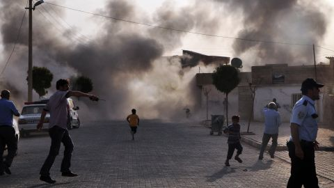 """Smoke rises after the explosion on Wednesday. <a href=""""http://www.cnn.com/2012/07/16/middleeast/gallery/syria-unrest/index.html"""" target=""""_blank"""">See photos of Syria's civil fighting.</a>"""