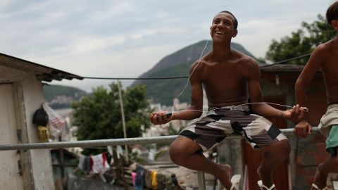 """Imitations of well known smartphones are commonly traded on the favelas' """"grey market"""", with brands such as """"HiPhone"""" offering music, touch screens, GPS and digital TV, just like their highly priced rivals."""