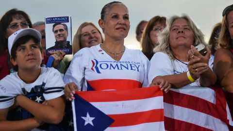 Romney supporters listen during Friday's campaign event in St. Petersburg.