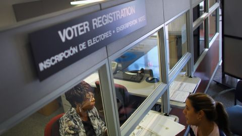 MIAMI, FL - OCTOBER 01: Dorothy Torrence (L), from the Miami-Dade Elections Department, helps Viviana Camacho with information about her voter registration on October 1, 2012 in Miami, Florida. With the October ninth deadline for people to register to vote in the upcoming election approaching, the Florida Department of State says the number of people registering to vote is now averaging between 1,500 and 3,000 a day. Democrats have been questioning the motives of the Republican led legislator's plan to purge alleged non-citizens from the voting lists and roll back early voting. According to reports, the Republican Party fired a voter registration contactor last week after allegations that the firm, Strategic Allied Consulting, turned in incorrect and falsified voter registration forms to Florida election officials. (Photo by Joe Raedle/Getty Images)