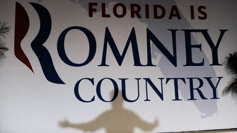 Romney casts a shadow on a banner as he speaks during a campaign event in Apopka, Florida, on Saturday, October 6.