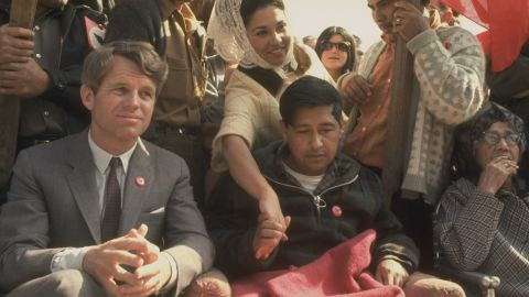 Robert F. Kennedy, left, sits next to Cesar Chavez, looking very weak after prolonged hunger strike.