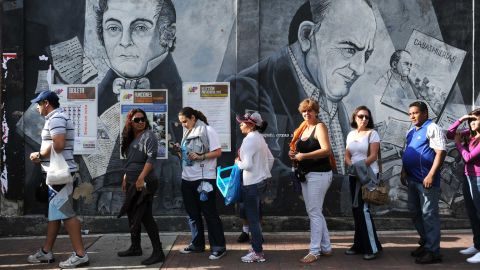 Venezuelans line up Sunday to cast their votes at a polling station in Caracas.