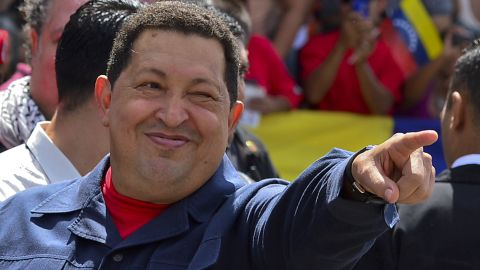 """Chavez greets a crowd before voting Sunday. The 58-year-old leader has been weakened by two surgeries for cancer, keeping secret the type of cancer and his prognosis. <a href=""""http://www.cnn.com/2012/10/03/americas/gallery/venezuela-election/index.html"""" target=""""_blank"""">Photos: Venezuela's presidential vote</a>"""