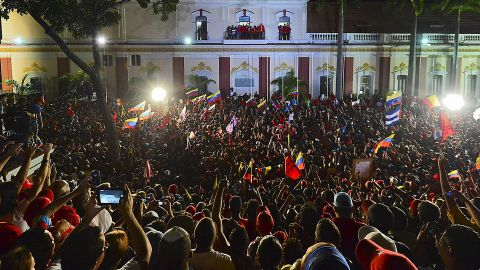 The Venezuelan leader addresses supporters Sunday night in Caracas. Fireworks peppered the sky over the capital soon after the provisional results were announced.