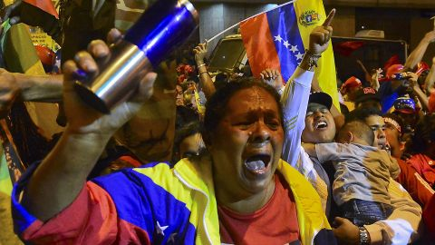 Chavez backers cheer Sunday night as provisional returns show the president won a new six-year term.