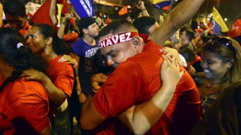Chavez supporters celebrate after receiving news of his victory Sunday night in Caracas.