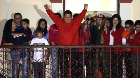 """Venezuelan President Hugo Chavez greets supporters after receiving news of his re-election in Caracas on Sunday, October 7. With 90% of the ballots counted, Chavez, who has been president since 1999, defeated Henrique Capriles Radonski with 54.42% of the votes, according to an National Electoral Council official.<a href=""""http://www.cnn.com/2012/10/03/americas/gallery/venezuela-election/index.html"""" target=""""_blank""""> Photos: Venezuela's presidential vote</a>"""