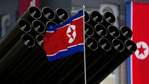 A North Korean flag flies before missiles displayed during a military parade to mark 100 years since the birth of the country's founder Kim Il-Sung in Pyongyang on April 15, 2012.