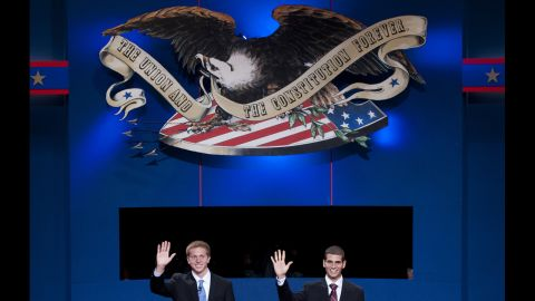 Centre College students Ben Boone, left, a stand-in for U.S. Vice President Joe Biden, and Tommy Munoz, a stand-in for Republican Vice Presidential candidate Paul Ryan, wave during a rehearsal for the vice presidential debate in Danville, Kentucky, on Wednesday.