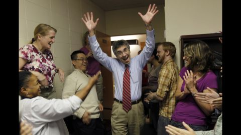 Robert Lefkowitz, center, enters a party held for him at Duke University after winning the Nobel Prize in chemistry on Wednesday. Lefkowitz shares the prize with his former student, Brian Kobilka.