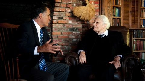 Romney, left, speaks with the Rev. Billy Graham during a visit to the Graham cabin in Montreat, North Carolina, on Thursday.