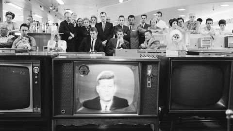A group of cutomers in an unidentified store gather in the electronics department to watch American President John F. Kennedy as he delivers a televised address to the nation on the subject of the Cuban Missile Crisis on October 22, 1962.