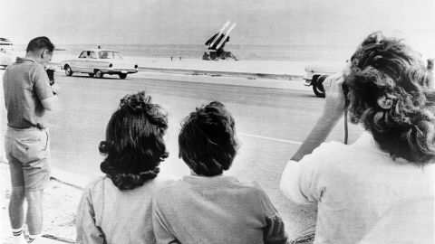 Onlookers gather on George Smathers Beach in Key West, Florida, to see the U.S. Army's Hawk anti-aircraft missiles positioned there during the Cuban missile crisis.