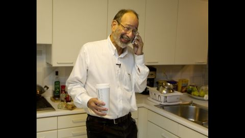 """Alvin Roth receives congratulatory phone calls at his home in Menlo Park, California, on Monday, October 15, after winning the Nobel Memorial Prize in Economics, which he shared with Lloyd Shapley. Roth was """"surprised"""" and """"delighted"""" when he got the midnight call at his California home telling him he had won."""
