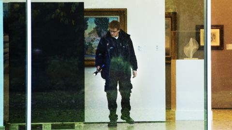 A investigator searches the Rotterdam Kunsthal museum following the break-in. The stolen works belong to a private collection that was being shown to the public for the first time.