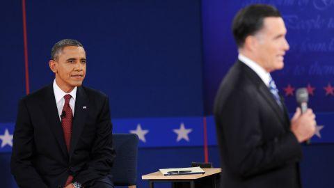 President Obama awaits his turn to speak.