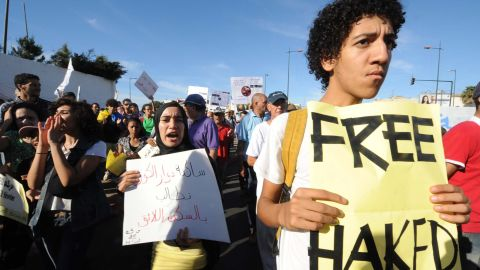 """Rapper Mouad Belghouat, better known as """"Al Haqed"""" (""""The Enraged One""""), became a figurehead for the pro-reform February 20 Movement when he was arrested in March 2011 for his song """"Kilab Al Dawla"""" or """"Dogs of the State,"""" in which criticizes the police for brutality and corruption. Here, a protestor is pictured demanding the release of Belghouat, days after his arrest."""