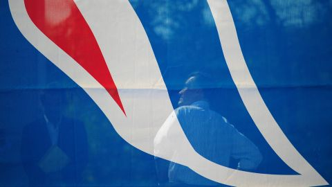 Mitt Romney is seen backstage through a campaign flag as he waits to take the stage at a rally in Chesapeake, Virginia, on Wednesday.