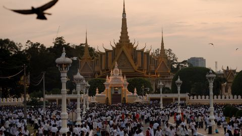 The sun sets as mourners burn incense and offer prayers for the late former king at the Royal Palace in Phnom Penh on Wednesday.