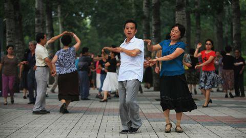 Beijing residents practice ballroom dancing in a park on July 31, 2008 in Beijing, China.