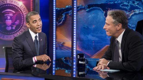 """Barack Obama and Jon Stewart speak during a break in the live taping of Comedy Central's """"The Daily Show with Jon Stewart"""" on Thursday."""