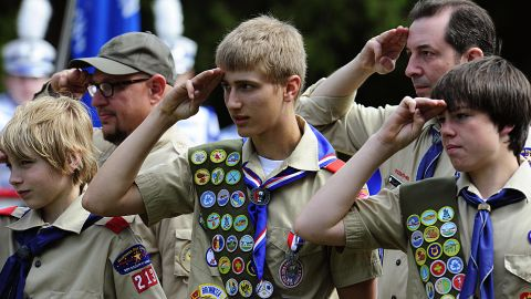 Members of the Boy Scouts salute during the raising of the flag on May 25, 2009 at the Willow River Cemetery in Hudson, Wisconsin during Memorial Day ceremonies. Cities and towns across the US Held ceremonies to honor those who served in the military and those who died in wars. AFP PHOTO/Karen BLEIER (Photo credit should read KAREN BLEIER/AFP/Getty Images)