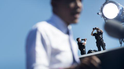 Secret Service members watch Thursday as President Obama speaks at Veterans Memorial Park in Manchester, New Hampshire.