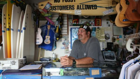 Surf shop owner Wayno Cochran tries to convince surfers to care about environmental issues.