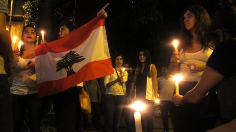 Lebanese people take part in a candlelight vigil near the site of the car bomb blast.