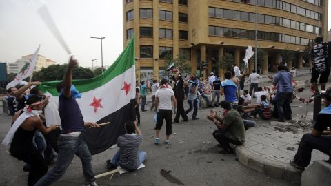 Protesters hurled sticks, stones and flags on Sunday. A number of injuries were reported, Lebanon's National News Agency said.