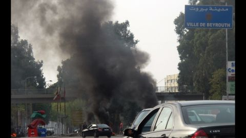 Smoke rises from burning tyres blocking the main northern entrance of Beirut on Saturday. Protesters blocked some roads in Beirut, Tripoli in the north, Sidon in the south, and the Bekaa Valley in the east.