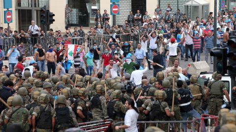 Demonstrators face off with Lebanese security forces on Sunday as they try to storm the palace.